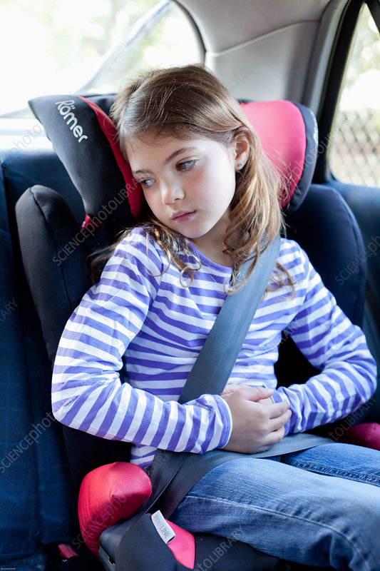 Girl looking sick in a car - Stock Image