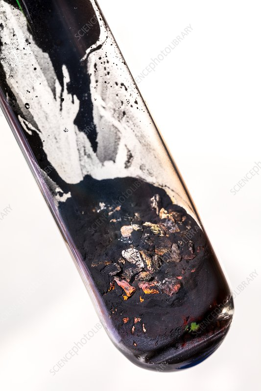 Smelting copper from copper oxide - Stock Image - C035/9323