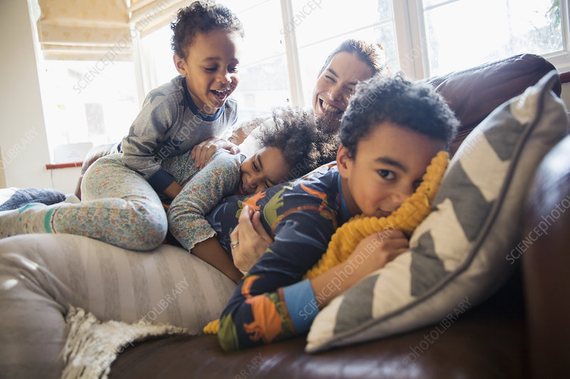 Mother And Children Cuddling On Sofa   Stock Image   F022 ...