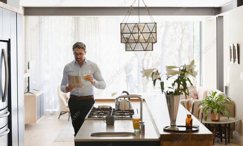 Businessman Reading Newspaper In Morning Kitchen Stock Image F031 1252 Science Photo Library