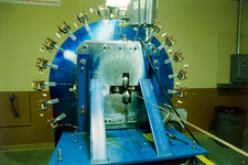 Apparatus to make superconducting magnets