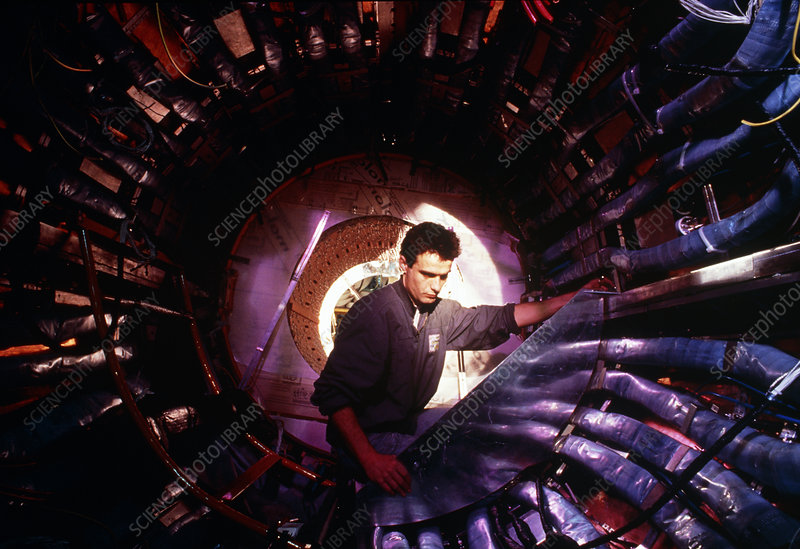 Technician working on L3 detector, CERN