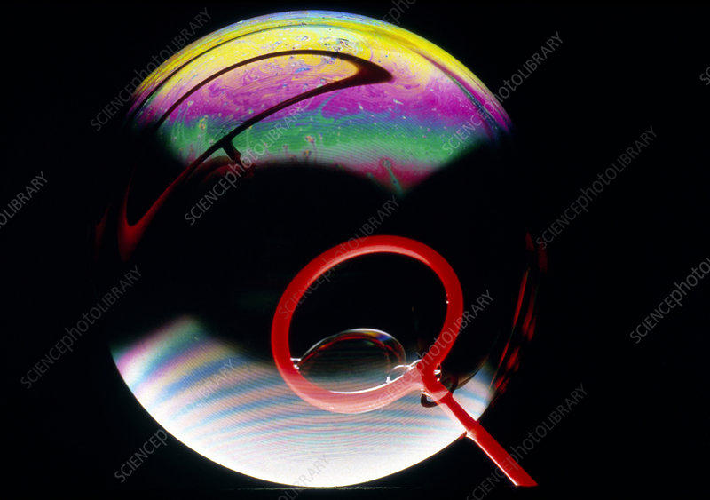 Soap bubble with light interference patterns