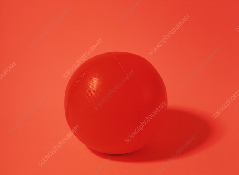 Red ball under red light