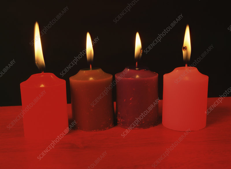 Candles under red light
