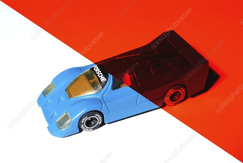 Blue toy car under red light