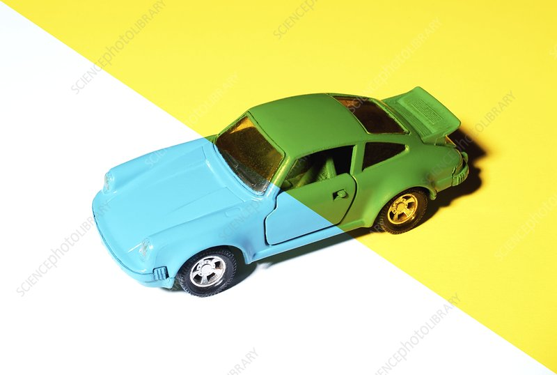 Cyan coloured toy car under yellow light