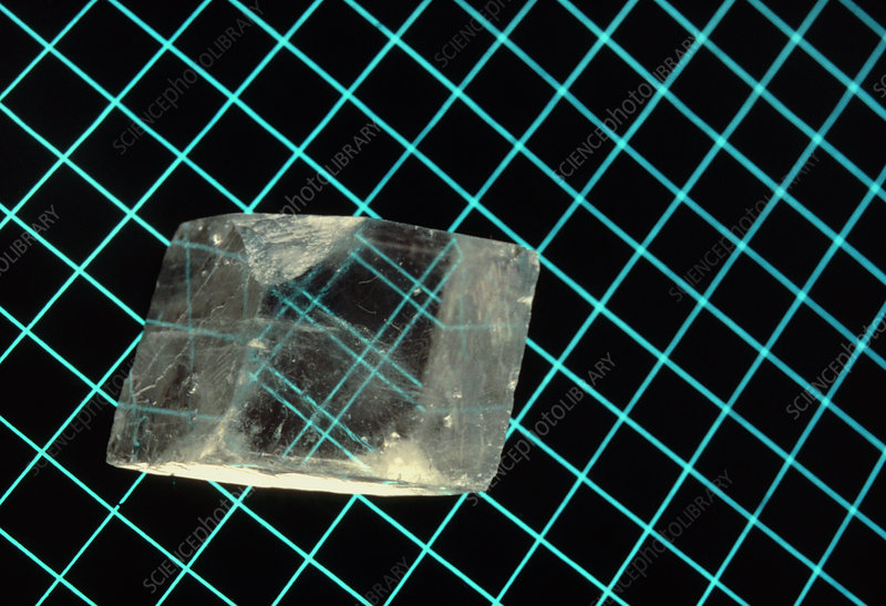 Calcite crystal upon a grid pattern