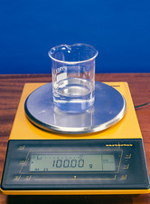 Water in beaker on scales