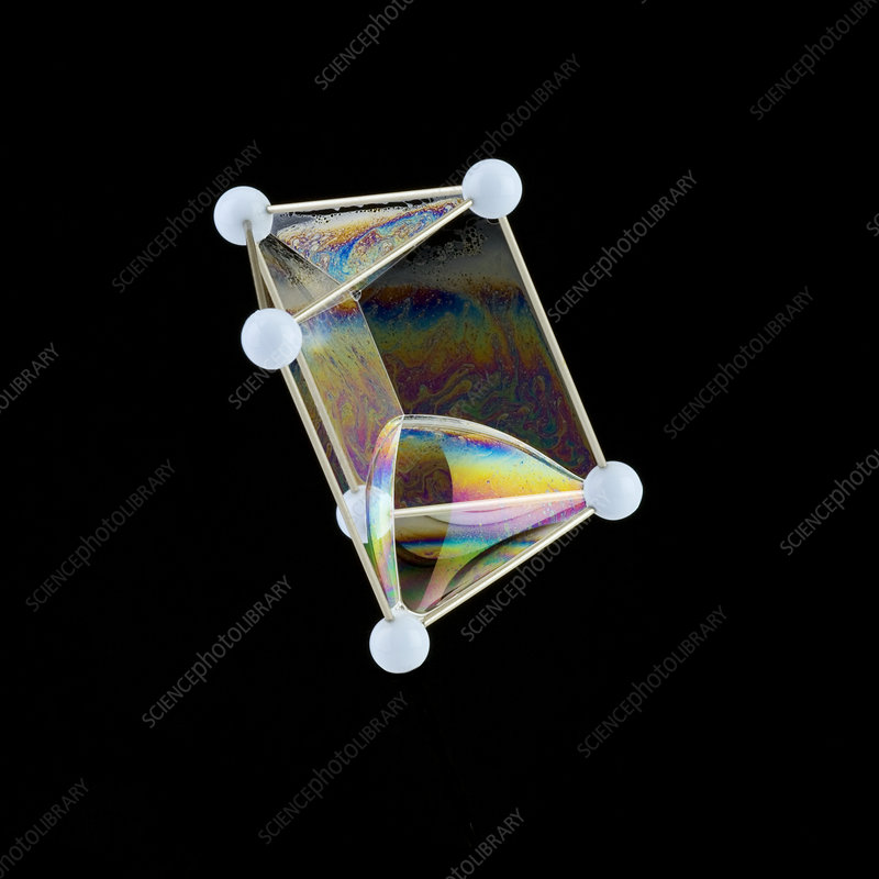 Soap bubbles on a triangular prism frame