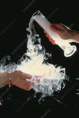 Dry ice being poured into cupped hands