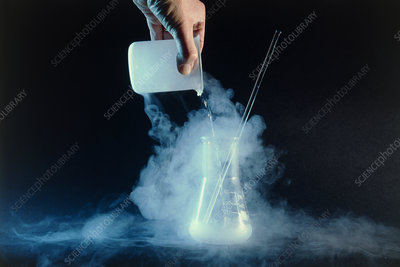 Liquid nitrogen being poured into flask
