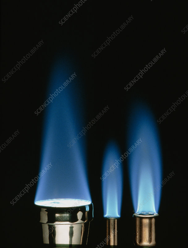 Blue flames of three bunsen burners
