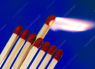 Close-up of a set of matches igniting