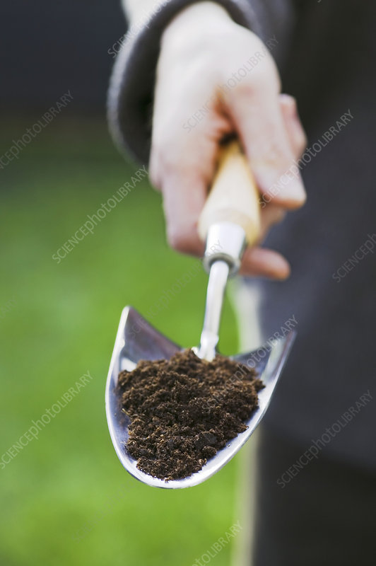 Trowel with potting compost