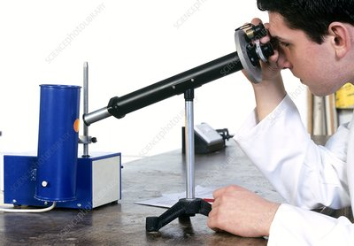 Student using a chemical polarimeter