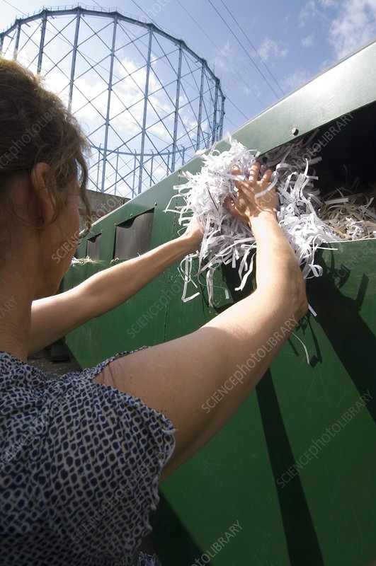 Woman recycling paper