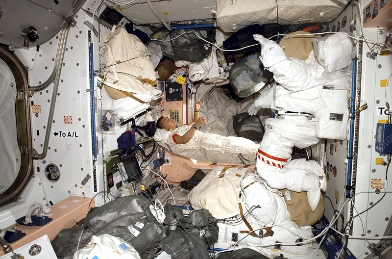 ISS astronaut sleeping, Expedition 16