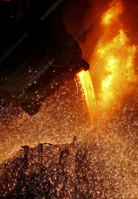 Molten metal being poured from a vat