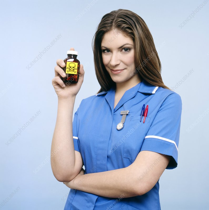 Nurse holding a bottle of harmful drugs