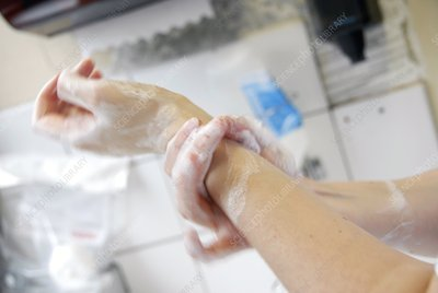 Nurse cleaning her hands
