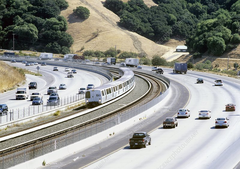 Train and motorway, California, USA