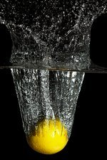 Lemon impacting water, high-speed image