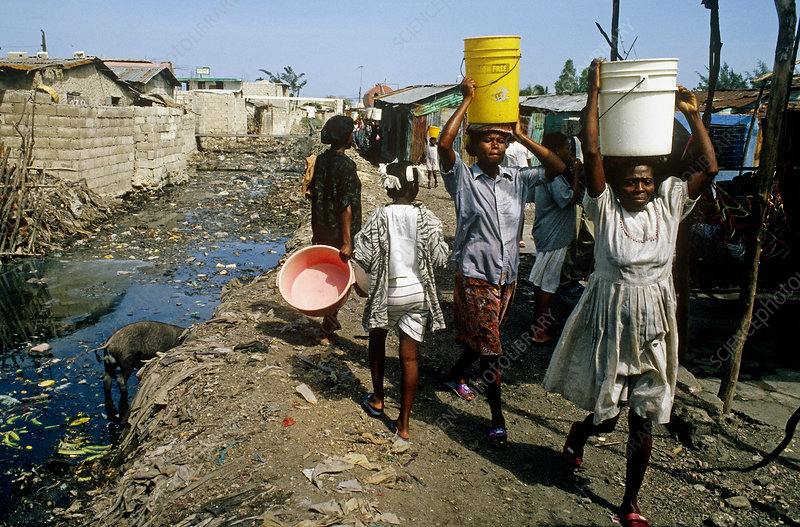 Image result for haiti women carry buckets