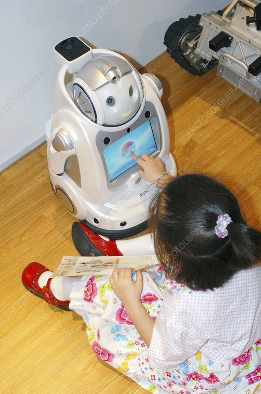 iRobi Q domestic toy robot and girl