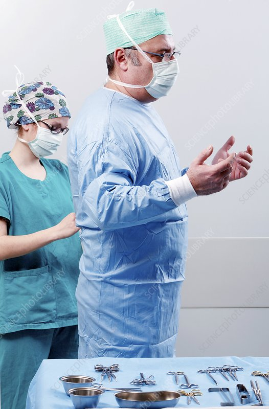 Surgeon being dressed