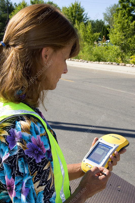 Woman Using GIS Device
