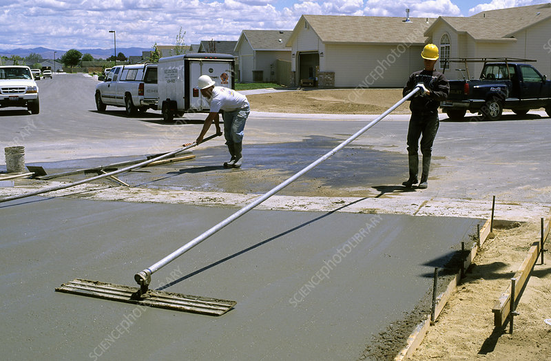 Workers Smoothing Concrete