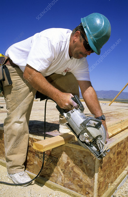Carpenter Cutting Lumber