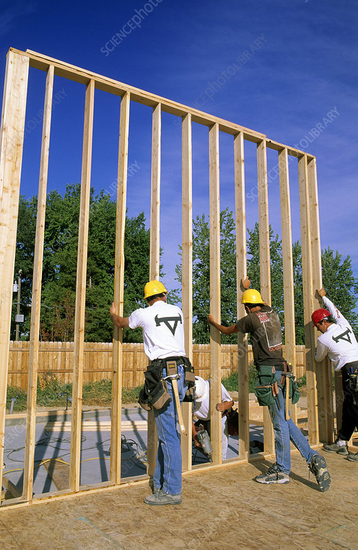 Construction Workers Lifting a Wall