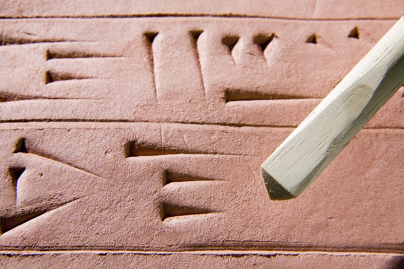 Cuneiform clay tablet and stylus