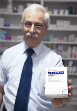 Pharmacist with Relenza packet