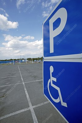 Disabled parking sign in empty car park