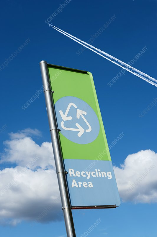 Recycling sign with jet contrail