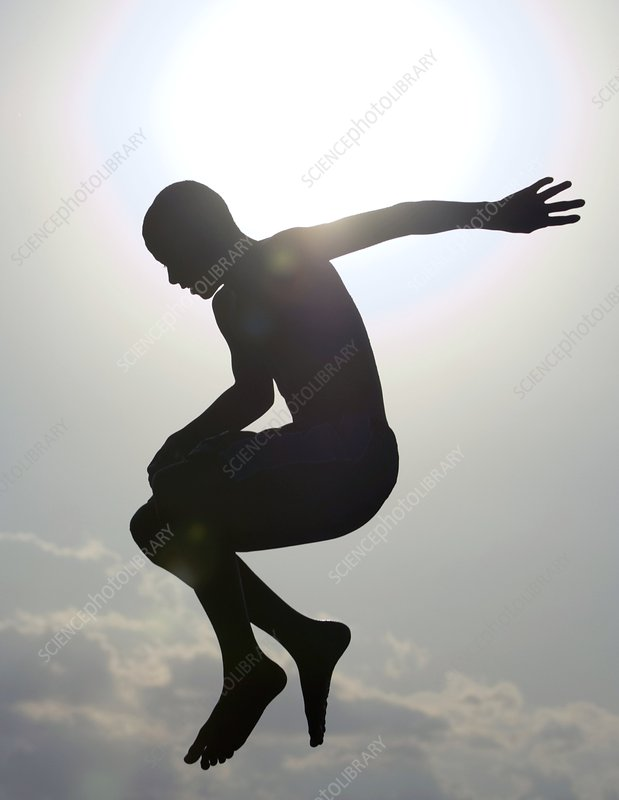 Silhouette of a boy jumping in the air