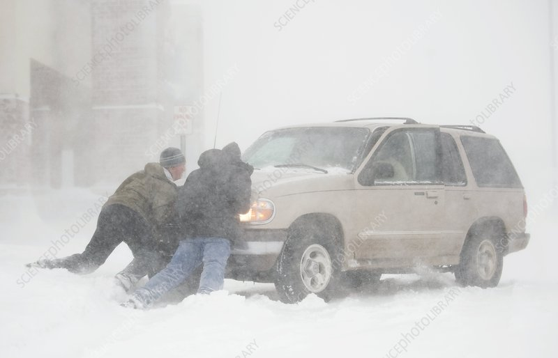 Pushing a car in a blizzard