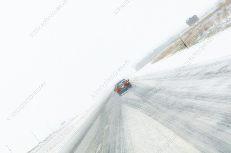 Car driving through heavy snow