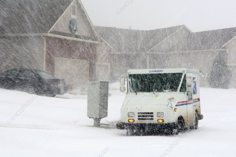 U.S. Mail truck in heavy snow