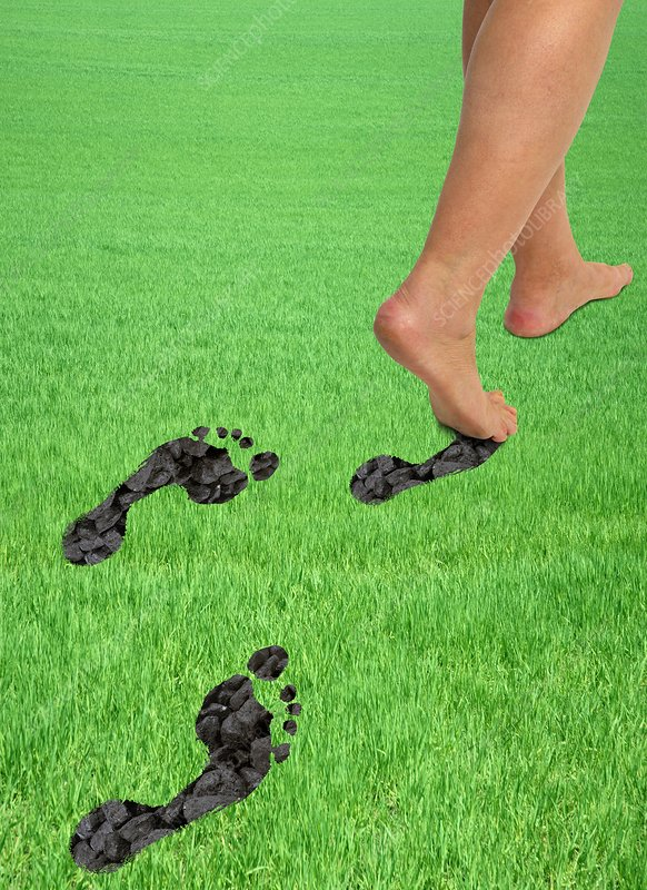 A woman's feet leaving carbon footprints