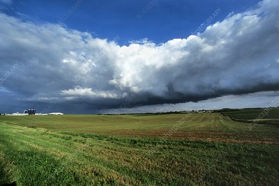 Cold front storm clouds over fields