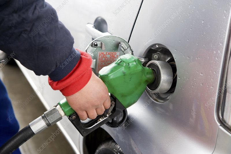 Motorist filling his petrol tank