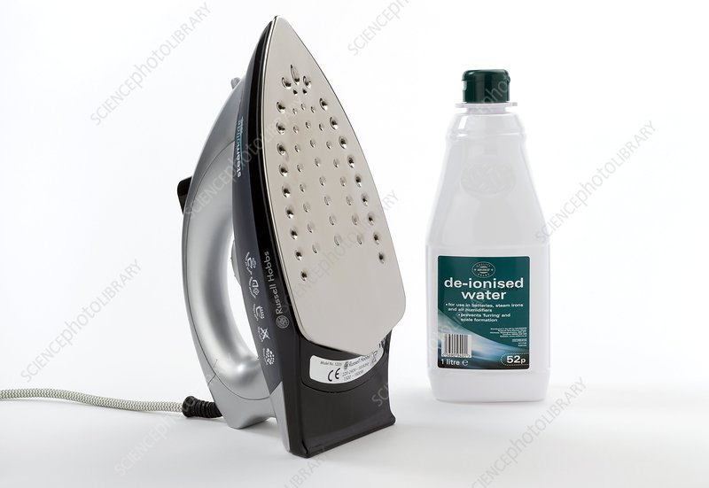 Steam iron and de-ionised water