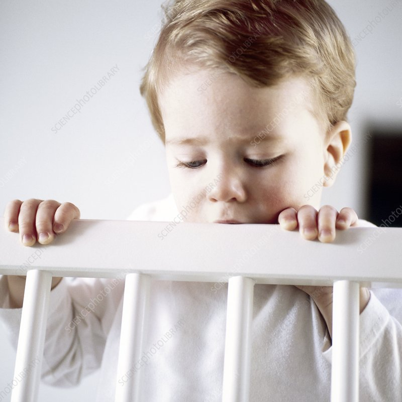 Toddler in his cot