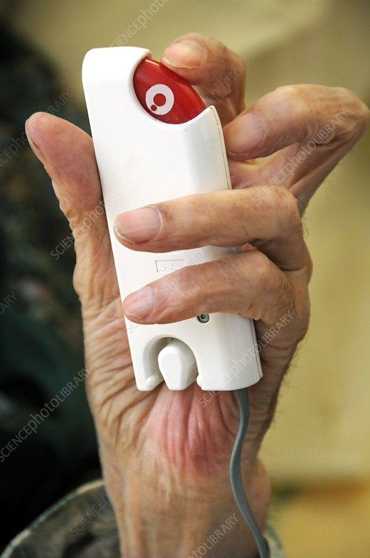 Hospital patient uses handheld alarm