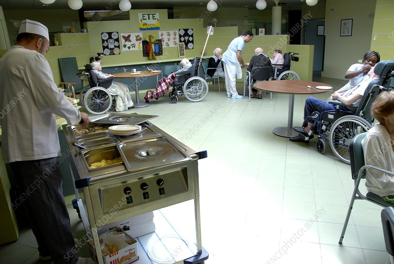 Alzheimer's patients eating in a care hom