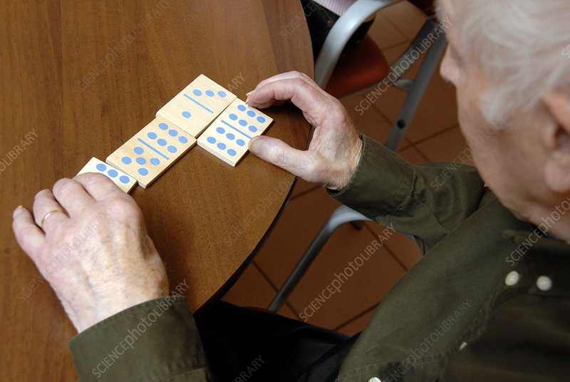 Alzheimer's patient plays dominoes